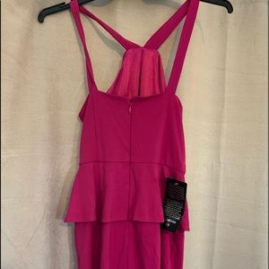 Bebe dress with straps.  no stains or blemish.